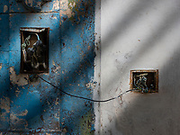 Exposed junction boxes on exterior of building in Havana.
