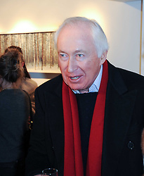 SIR JOHN BECKWITH at a private view of photographs held at the Little Black Gallery, Park Walk, London on 20th January 2010.
