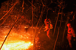 May 4, 2017 - Inner Mongolia, China - Firefighters battle a wildfire at Beidahe forest farm in the Greater Hinggan Mountain region. Thousands of firefighters are battling the blaze in northern China, which broke out Tuesday.  (Credit Image: © Lian Zhen/Xinhua via ZUMA Wire)