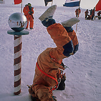 Expedition leader Will Steger plays beside the ceremonial South Pole, halfway through the 1989-1990 Trans-Antarctica Expedition.