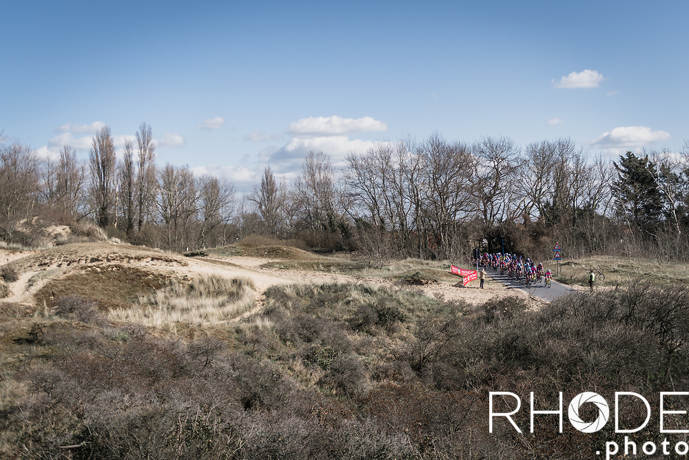 peloton rolling through the dunes<br /> <br /> Oxyclean Classic Brugge-De Panne 2021 (WE/1.WWT) - Belgium<br /> 1 day race from Brugge to De Panne (159km)<br /> <br /> ©RhodePhoto