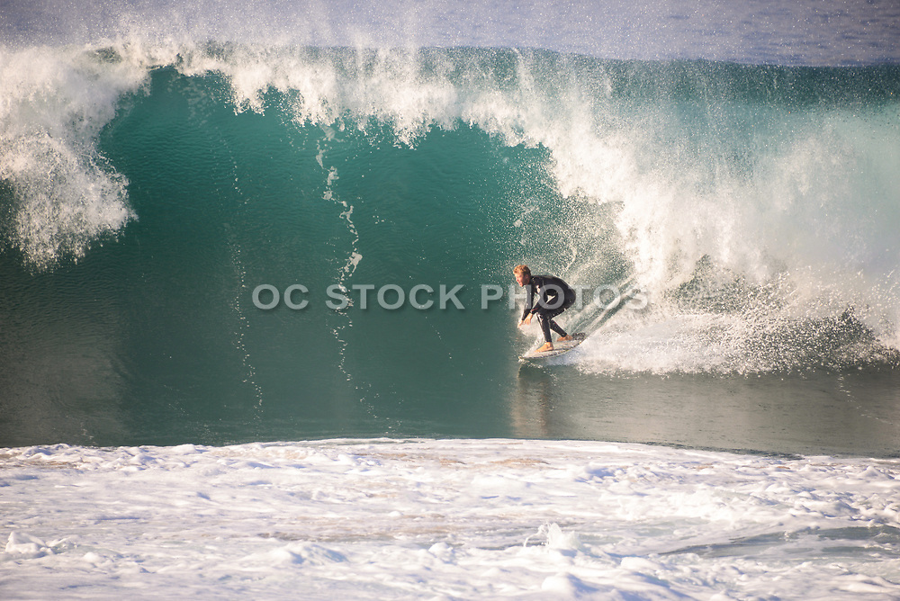 Male Surfer Riding a Huge Wave at the Wedge in Newport Beach California