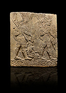 Hittite sculpted Orthostats panel of Long Wall Limestone, Karkamıs, (Kargamıs), Carchemish (Karkemish), 900-700 B.C. Soldiers. Anatolian Civilisations Museum, Ankara, Turkey<br /> <br /> Figure of two helmeted warriors. They have their shield in their back and their spear in their hand. The prisoner in their front is depicted small. A human head is depicted in the left hand of the warrior in the front. The warrior at the rear holds the prisoners sitting on his lap from his hair. Below this figure, which was described small, lies yet another small human figure. <br /> <br /> On a black background. .<br />  <br /> If you prefer to buy from our ALAMY STOCK LIBRARY page at https://www.alamy.com/portfolio/paul-williams-funkystock/hittite-art-antiquities.html  - Type  Karkamıs in LOWER SEARCH WITHIN GALLERY box. Refine search by adding background colour, place, museum etc.<br /> <br /> Visit our HITTITE PHOTO COLLECTIONS for more photos to download or buy as wall art prints https://funkystock.photoshelter.com/gallery-collection/The-Hittites-Art-Artefacts-Antiquities-Historic-Sites-Pictures-Images-of/C0000NUBSMhSc3Oo