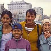 Cuban family walking on El Malecon, Havana, Cuba