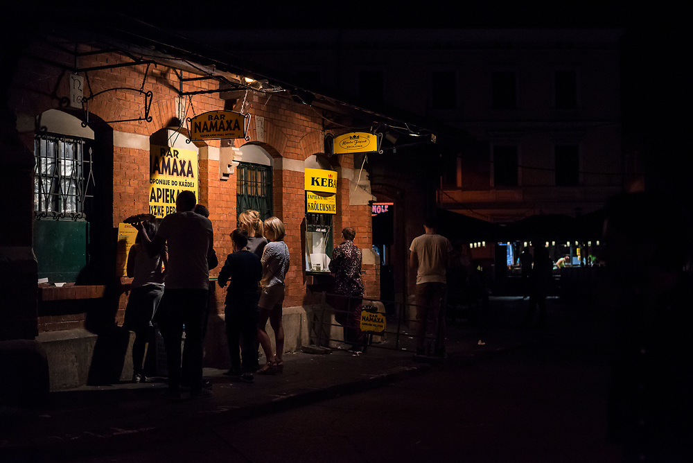 At 1:40 a.m., people order food and drink at Plac Nowy, or New Square, in the Kazimierz Jewish quarter of Krakow, Poland. (August 28, 2016)