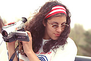 Spectator age 17 recording Cinco de Mayo parade.  St Paul Minnesota USA
