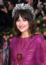 """Dakota Johnson at the 2019 Costume Institute Benefit Gala celebrating the opening of """"Camp: Notes on Fashion"""".<br />(The Metropolitan Museum of Art, NYC)"""