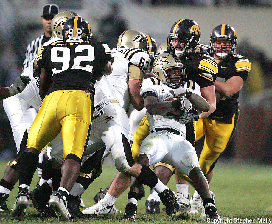 17 NOVEMBER 2007: Western Michigan running back Brandon West (2) fights for extra yards in Western Michigan's 28-19 win over Iowa at Kinnick Stadium in Iowa City, Iowa on November 17, 2007.