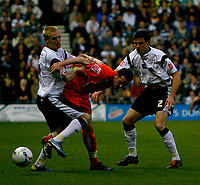 Photo: Steve Bond.<br />Derby County v Luton Town. Coca Cola Championship. 20/04/2007.  Gary Teale (L) scraps for the ball
