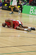 Jerry Smith of the Pistons in pain after he falls and twists his knee during their NBL Game at Hamilton,,Basketball,Pistons Vs Jets, Wednesday 22 June 2011.<br /> Photo: Dion Mellow / photosport.co.nz