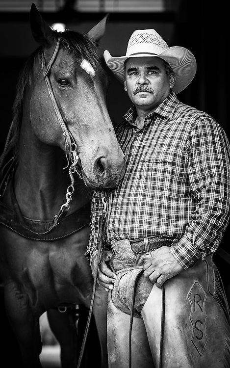 """King Ranch Pure Bred Unit Manager and Cowboy Robert Silguero with his horse 'Signs""""."""