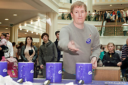 """Cadburys Spots vs Stripes Challenge Race Season Meadowhall Sheffield.Nick Icke tries his hand at being the """"fastest tea maker"""".2 April 2011.Images © Paul David Drabble"""
