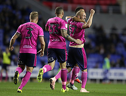 Queens Park Rangers's Toni Leistner celebrates with his team mates after he scores their side's first goal of the game during the Sky Bet Championship match between Reading and Queens Park Rangers.