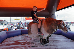 03 August 2017:  A young boy rides a mechanical bull at 2017 McLean County Fair<br /> <br /> #alphoto513