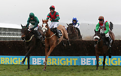 Eventual winner Kildisart ridden by Daryl Jacob (left) jumps with First Drift ridden by Max Kendrick and Spiritofthegames ridden by Harry Skelton in the Timeform Novices' Handicap Chase during Festival Trials Day at Cheltenham Racecourse.