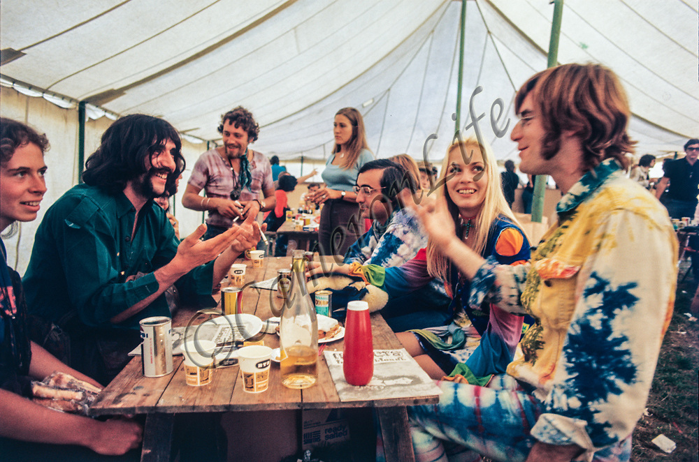 John and Catherine Sebastian and Zal Yanovski in the refreshment tent - 1970 Isle of Wight Music Festival (displayed as one of 28 images in the slideshow exhibit of Charles Everest's photographs at the V&A)