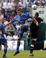 Photo: Olly Greenwood.<br />Gillingham v Swansea City. Coca Cola League 1. 16/09/2006. Gillingham's Gary Mulligan and Swansea's Kevin Austin (R) battle.