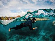 Scuba diver drag a raft, Punta fuego, Batangas Province, Philippines, Southeast Asia, 2016