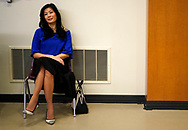 Evelyn Yang, wife of Democratic 2020 U.S. presidential candidate and entrepreneur Andrew Yang, listens to her husband at a town hall meeting  in Sioux City, Iowa, January 27, 2020.     REUTERS/Rick Wilking