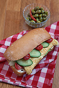 omelet sandwich with tomato and cucumber