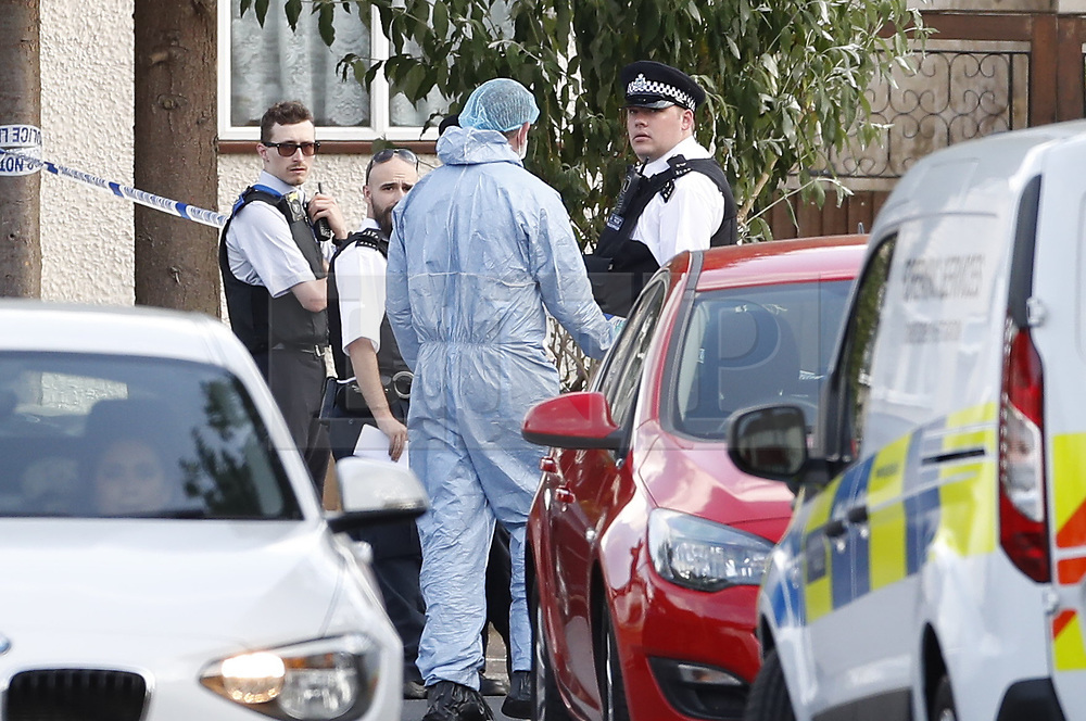 © Licensed to London News Pictures. 12/07/2019. London, UK. The scene at a residential address in Redfern Avenue, Whitton, South West London where a man and a woman have been fatally stabbed. A 31-year-old man was arrested after a man, aged in his 60s, and a woman, aged in her 70s were found at the property with stab injuries. Photo credit: Peter Macdiarmid/LNP