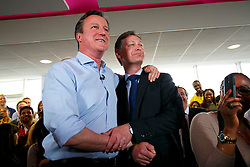 © Licensed to London News Pictures. 05/05/2015. LONDON, UK. Conservatives leader and Prime Minister David Cameron and Tory candidate for Hendon Matthew Offord speaking to staff at Utility Warehouse in Hendon, northwest London on Tuesday, 5 May 2015. Photo credit : Tolga Akmen/LNP