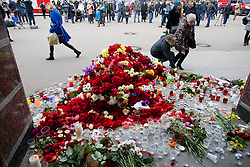 April 4, 2017 - Saint Petersburg, Russia - People lay flowers at the metro station ''Spasskaya'' in memory of the victims of the terrorist attack in St. Petersburg metro, which killed 14 people. St. Petersburg, Russia, April 4 , 2017. Russian police continue investigations after 14 people were killed and dozens injured in St Petersburg following explosions between two of the city's underground stations. The suspect is reportedly a native of Kyrgyzstan named as Akbarzhon Jalilov who obtained Russian citizenship, according to the Central Asian country's security service. Authorities in St Petersburg have declared three days of mourning. (Credit Image: © Valya Egorshin/NurPhoto via ZUMA Press)