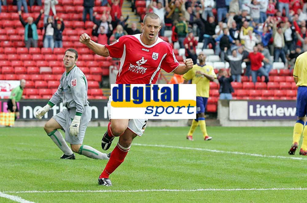 Photo: Paul Thomas.<br /> Barnsley v Southampton. Coca Cola Championship. 19/08/2006.<br /> <br /> Marc Richards of Barnsley (R) celebrates his goal for Barnsley while Southampton keeper Kelvin Davis (L) is unhappy.