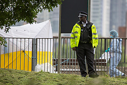 © Licensed to London News Pictures.  30/07/2021. London, UK. Police and forensic officer at the the crime scene after a 30 year old male has been fatally stabbed in Greenwich, south London. Male in his 20s has been arrested on suspicion of murder. Police were called at 1:06am to reports of a man stabbed. The victim died at 2:37. Photo credit: Marcin Nowak/LNP
