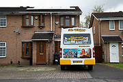 Mr Whippy ice cream van parked in front of a house in Birmingham, United Kingdom. This looks like a small business owner who uses his driveway at home for parking his vehicle.