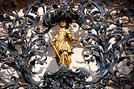 The figure of justice. Baroque lattice wraught iron work  work of Henrik Fazola (1730-99), County Hall, Eger, Hungary .<br /> <br /> Visit our HUNGARY HISTORIC PLACES PHOTO COLLECTIONS for more photos to download or buy as wall art prints https://funkystock.photoshelter.com/gallery-collection/Pictures-Images-of-Hungary-Photos-of-Hungarian-Historic-Landmark-Sites/C0000Te8AnPgxjRg