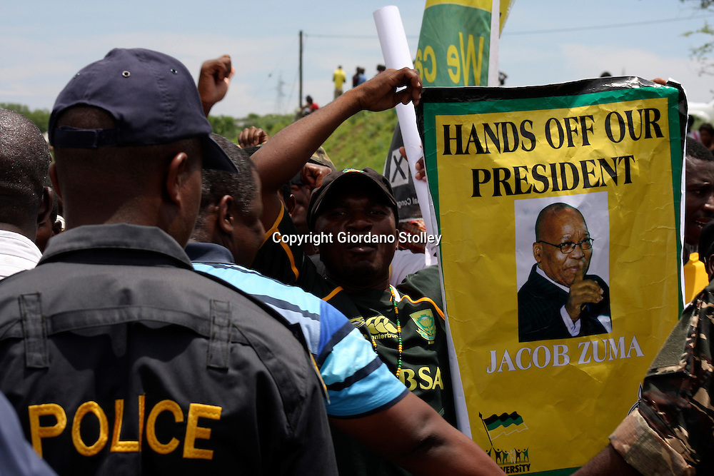 NKANDLA - 4 November 2012 - Stopped by police this supporter shows his support for President Jacob Zuma during a protest to stop DA leader Helen Zille from inspecting Jacob Zuma's Nkandla residence..Picture: Giordano Stolley/Allied Picture Press/APP