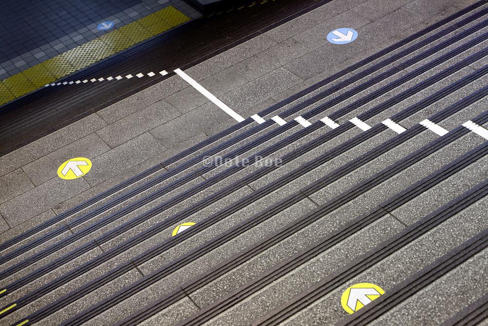 walking direction arrows at a train station Japan Tokyo