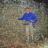 Gordon Wiltsie stands beside an ancient temple built in a Chachapoyan (pre-Inca) ceremonial site that he and archaeologist Dr. Peter Lerche found lost in the upper Amazon cloud forests of Peru's Cordillera Central.