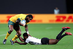 Australia's Marika Koroibete (right) and Fiji's Frank Lomani battle for the ball during the 2019 Rugby World Cup Pool D match at Sapporo Dome.
