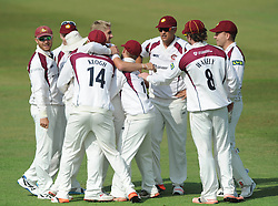 Olly Stone of Northamptonshire celebrates with team mates as Rory Kleinveldt of Northamptonshire catches out Chris Dent of Gloucestershire for 0 - Photo mandatory by-line: Dougie Allward/JMP - Mobile: 07966 386802 - 08/07/2015 - SPORT - Cricket - Cheltenham - Cheltenham College - LV=County Championship 2