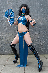© Licensed to London News Pictures. 24/05/2015. London, UK. A girl in blue latex, dressed as Kitana from Mortal Kombat poses, as fans of anime, comic books, video games and more gather in large numbers at the Excel Centre to attend the bi-annual MCM Comic Con. Photo credit : Stephen Chung/LNP