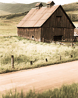 An historic barn sits along a country road near Crested Butte, Colorado.