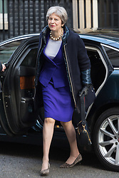London - British Prime Minister Theresa May arrives at 10 Downing Street after attending a function commemorating the Sufferagettes at the House of Commons. February 06 2018.
