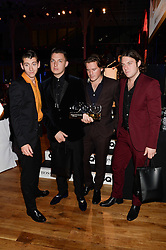 The Arctic Monkeys (L to R) Alex Turner, Matt Helders, Jamie Cook, and Nick O'Malley Winner of the Band of The year Award at the GQ Men of The Year Awards 2013 in association with Hugo Boss held at the Royal Opera House, London on 3rd September 2013.