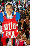 08 MAY 2013 - BANGKOK, THAILAND:  A Thai Red Shirt holds up a photo of US President Barack Obama at a Red Shirt protest at the Constitutional Court. Many Red Shirts like Pres Obama because they liken him to their exiled Prime Minister Thaksin Shinawatra. A splinter group of the Red Shirts, Thai supporters of exiled Prime Minister Thaksin Shinawatra, have besieged the Thai Constitutional Court for the last three weeks calling for the resignation of the justices, who have indicated they might oppose a proposed constitutional reform which would grant amnesty to people convicted of political crimes since 2007. This would probably include Thaksin. The justices have refused to step down. Wednesday the protesters moved their protest to the Thai Parliament, which is largely powerless to intervene.  PHOTO BY JACK KURTZ