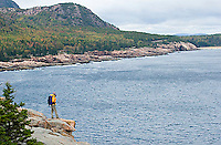 Young woman hiking in Acadia National Park. Bar Harbor Maine.<br />
