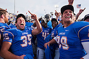 Dec 1, 2012; Tulsa, Ok, USA; Tulsa Hurricanes linebacker Matt Hickman (35) tailback James Flanders (42) and defensive end Thomas Shamet (89) react following a game against the University of Central Florida Knights at Skelly Field at H.A. Chapman Stadium. Tulsa defeated UCF 33-27 in overtime to win the CUSA Championship. Mandatory Credit: Beth Hall-USA TODAY Sports