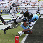 ORLANDO, FL - OCTOBER 24:  Wide receiver Jha'Quan Jackson #4 of the Tulane Green Wave scores a touchdown in front of defensive back Aaron Robinson #31 of the Central Florida Knights at Bounce House-FBC Mortgage Field on October 24, 2020 in Orlando, Florida. (Photo by Alex Menendez/Getty Images) *** Local Caption *** Jha'Quan Jackson; Aaron Robinson