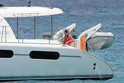 EXCLUSIVE: Abbey Clancy and Peter Crouch pictured on a romantic holiday while onboard a catamaran in Barbados. 12 Jun 2018 Pictured: Abbey Clancy and Peter Crouch . Photo credit: Shanice King/246paps / MEGA TheMegaAgency.com +1 888 505 6342