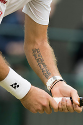 © Licensed to London News Pictures. 01/07/2016. close-up of STAN WAWRINKA left forearm tattoo on the fifth day of the WIMBLEDON Lawn Tennis Championships. London, UK. Photo credit: Ray Tang/LNP
