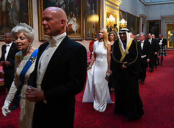 Princess Alexandra, The Honourable Lady Ogilvy and Lord Hague of Richmond, followed by Suzanne Ircha and the Ambassador of Kuwait arrive through the East Gallery during the State Banquet at Buckingham Palace, London, on day one of the US President's three day state visit to the UK.