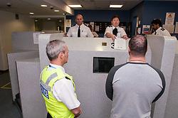 Suspect at charge desk, Middlesbough police station
