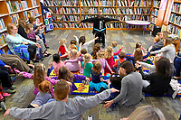 """Shabaz Ujima of the Nashville Ballet reads """"Little Cloud"""" by Eric Carle during story time at the Nolensville Library's pre-school Story Time  on March 13, 2019. Photo: Harrison McClary/News & Observer"""