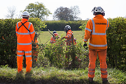 Quainton, UK. 26th April, 2021. Tree surgeons contracted to HS2 clear a section of hedgerow for a temporary access road for the HS2 high-speed rail link. Environmental activists continue to oppose the controversial HS2 infrastructure project from a series of protection camps along its Phase 1 route between London and Birmingham.